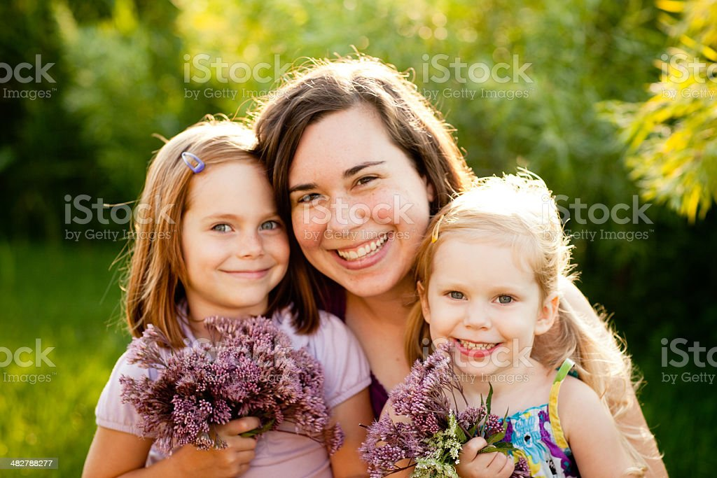 Mother and two daughters outside royalty-free stock photo
