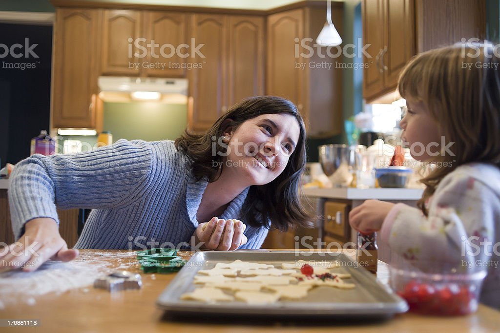 Mother and Two Year Old Daughter Baking Christmas Cookies stock photo