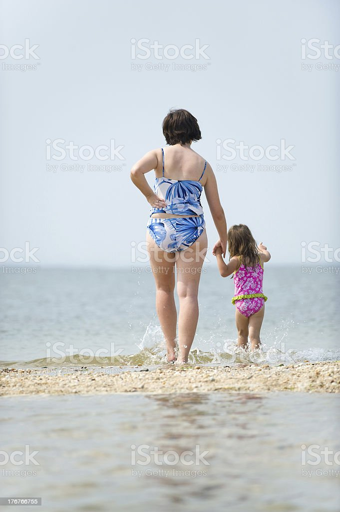 Mother and Young Daughter Ponder the Horizon royalty-free stock photo