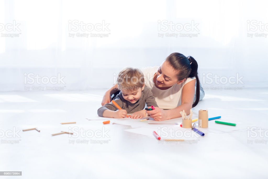 mother and young son painted pencils stock photo