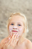 istock Mother applying sunscreen protection creme on cute little daughter face. Mom using sunblocking lotion to protect kid girl from sun during summer sea vacation. Children healthcare at travel time 1161825228