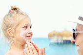 istock Mother applying sunscreen protection creme on cute little toddler boy face. Mom using sunblocking lotion to protect baby from sun during summer sea vacation. Children healthcare at travel time 1161825365