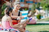 istock Mother applying suntan lotion on daughter 1197527169