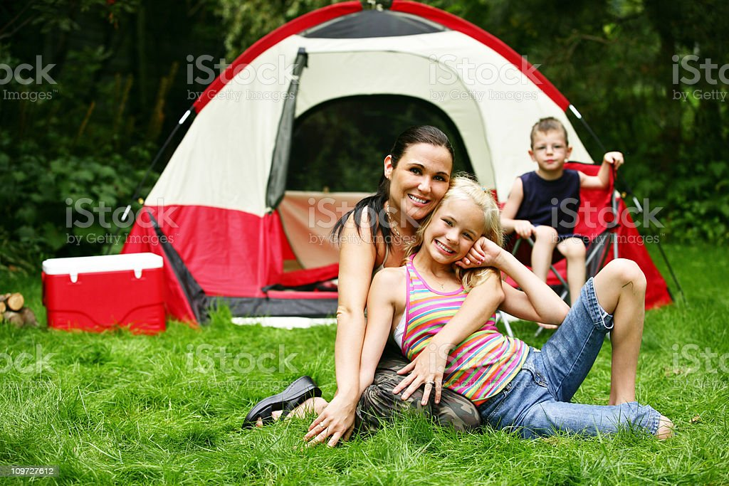 Mother at camping site with family royalty-free stock photo