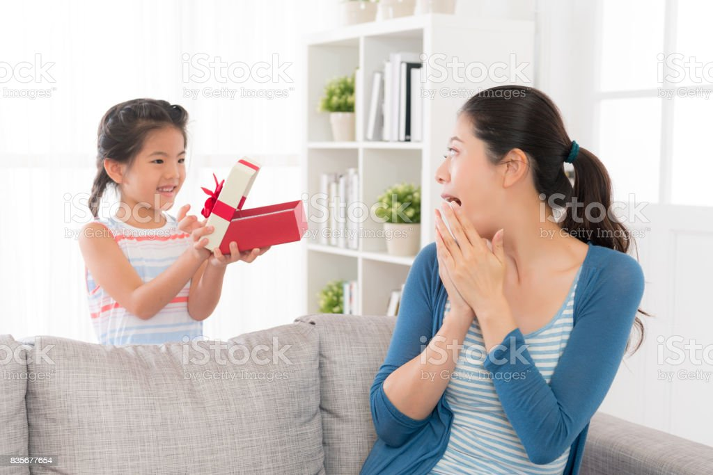 mother at the mothers day received a red gift stock photo