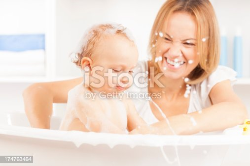 istock Mother bathing her baby boy 174763464