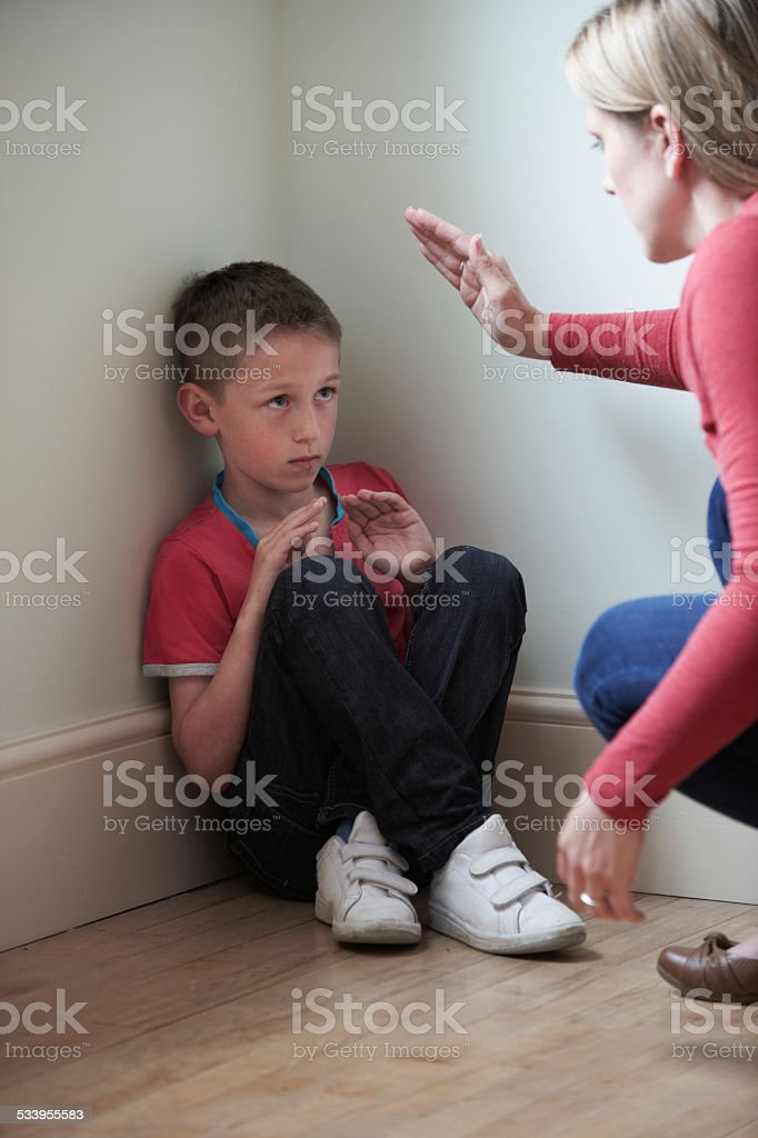 Mother Being Physically Abusive Towards Son At Home stock photo