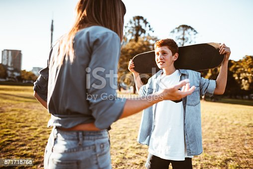 istock mother bothering the son with the skateboard 871718768