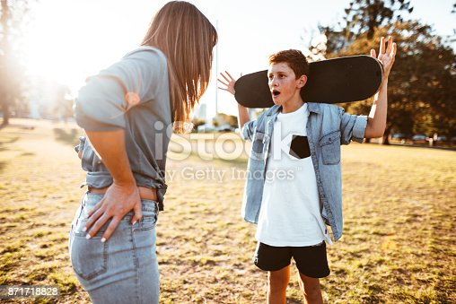 istock mother bothering the son with the skateboard 871718828