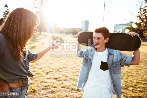 istock mother bothering the son with the skateboard 871718896