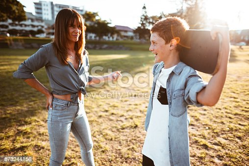istock mother bothering the son with the skateboard 873244156