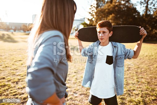 istock mother bothering the son with the skateboard 873245296