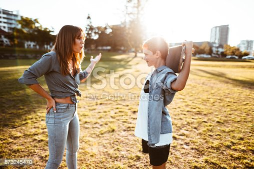 istock mother bothering the son with the skateboard 873245470