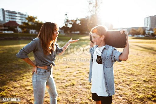 istock mother bothering the son with the skateboard 873245516