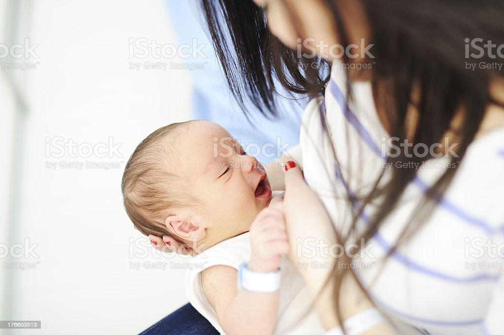 Mother breastfeeding a newborn baby royalty-free stock photo
