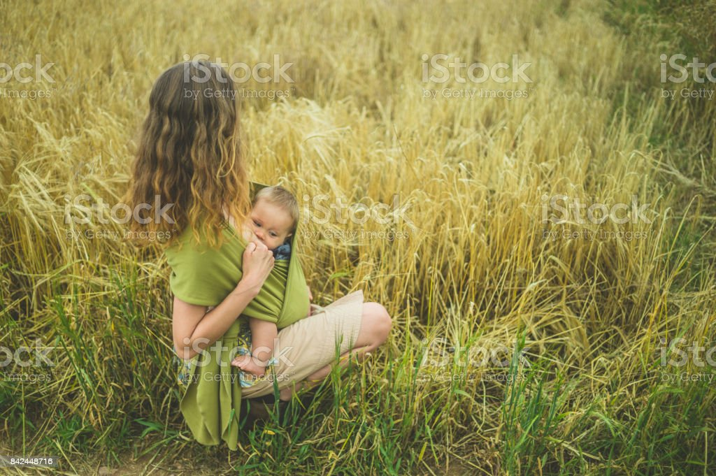 Mother Breastfeeding Baby In Field Stock Photo  More -1267