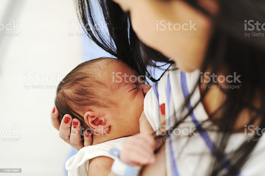 Mother Breastfeeding her newborn baby royalty-free stock photo