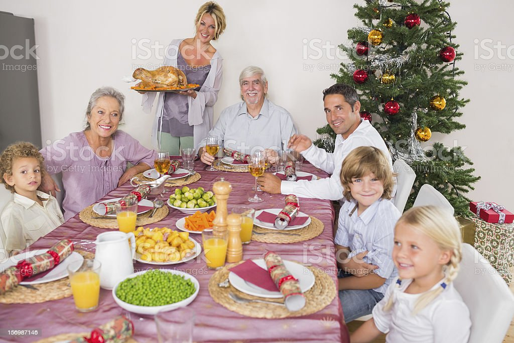 Mother bringing turkey to dinner table royalty-free stock photo