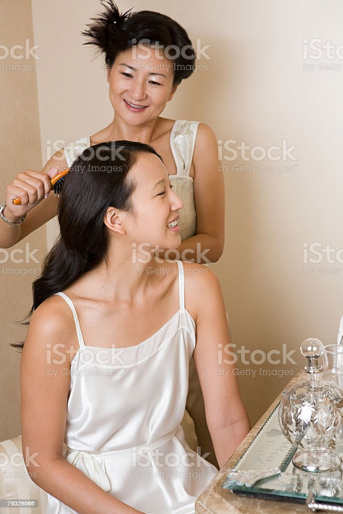 Mother brushing daughters hair royalty-free stock photo
