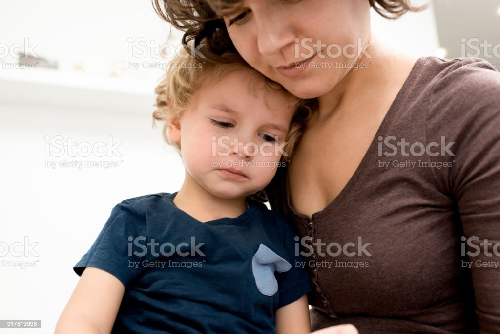 Mother Calming Crying Son stock photo
