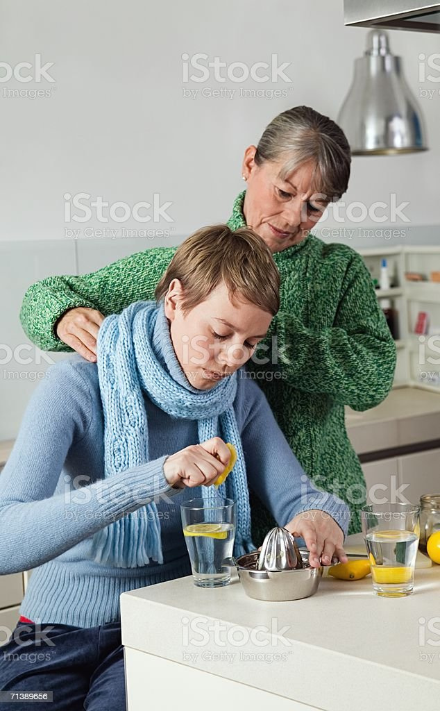 Mother caring for ill daughter royalty-free stock photo