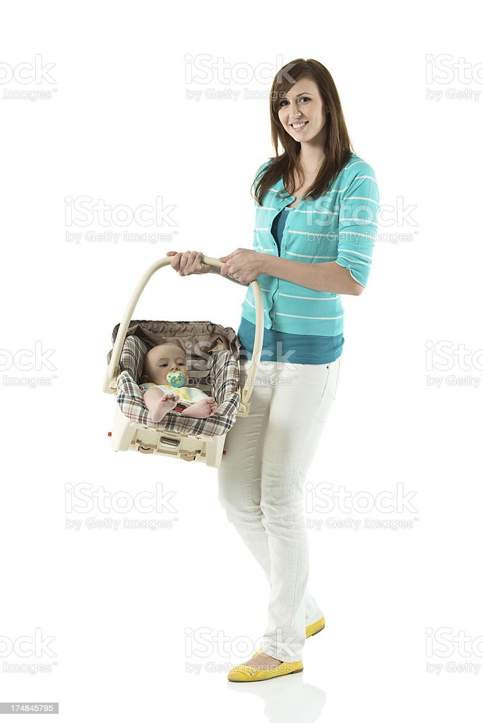 Mother carrying baby in basket royalty-free stock photo