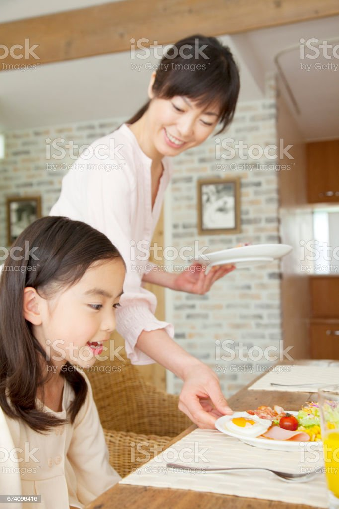 Mother carrying daughter breakfast royalty-free stock photo