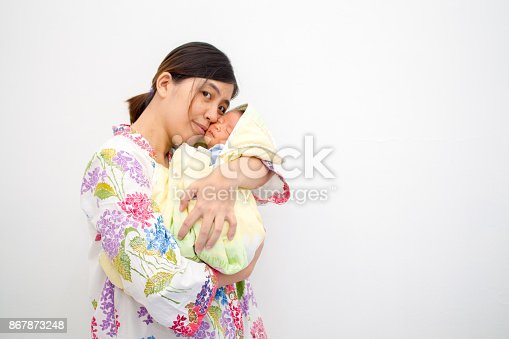 istock Mother Carrying Her Baby 867873248