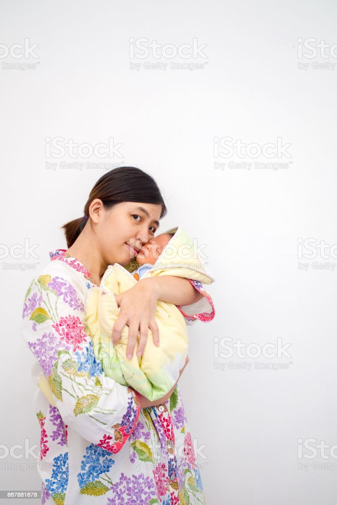 Mother Carrying Her Baby stock photo