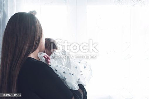 istock Mother carrying her little baby girl in her arms 1085221276