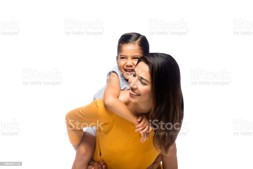 Mother carrying toddler girl stock photo