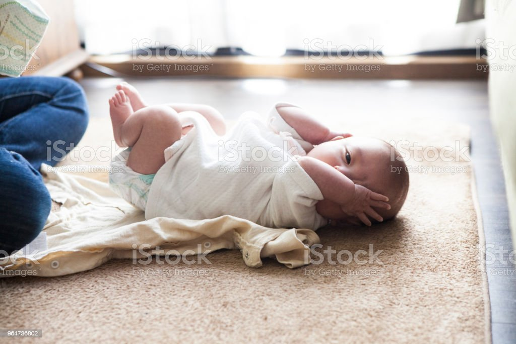 Mother changing baby clothes. royalty-free stock photo