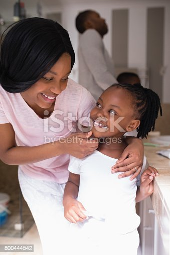 istock Mother checking daughters teeth in bathroom at home 800444542