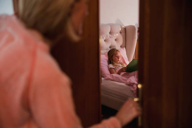 mother checks on daughter - mom spying stock photos and pictures