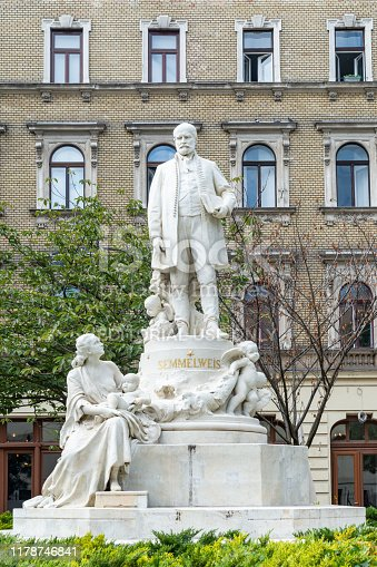 Budapest, Hungary - October 01, 2019: Mother, Child and Rescuer - Statue of doctor Ignac Semmelweis in front of Rokus Hospital. The statue is by Alajos Strobl (1906).