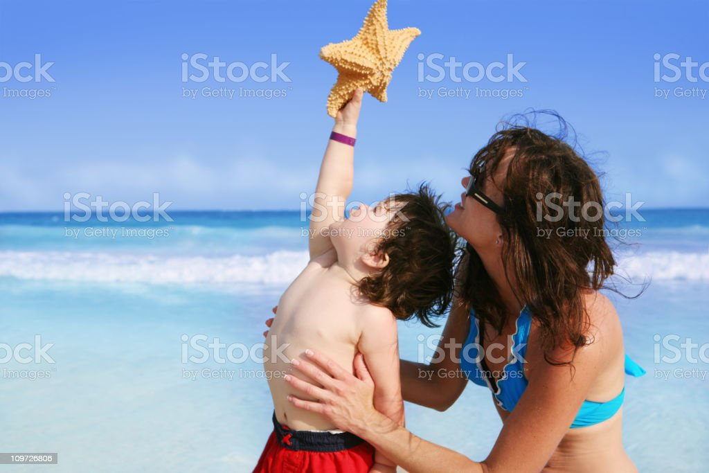 Mother, Child, Beach and Starfish royalty-free stock photo