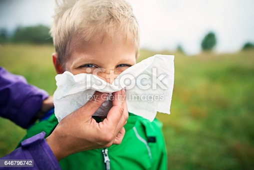 629307146istockphoto Mother cleaning nose of sick boy 646796742