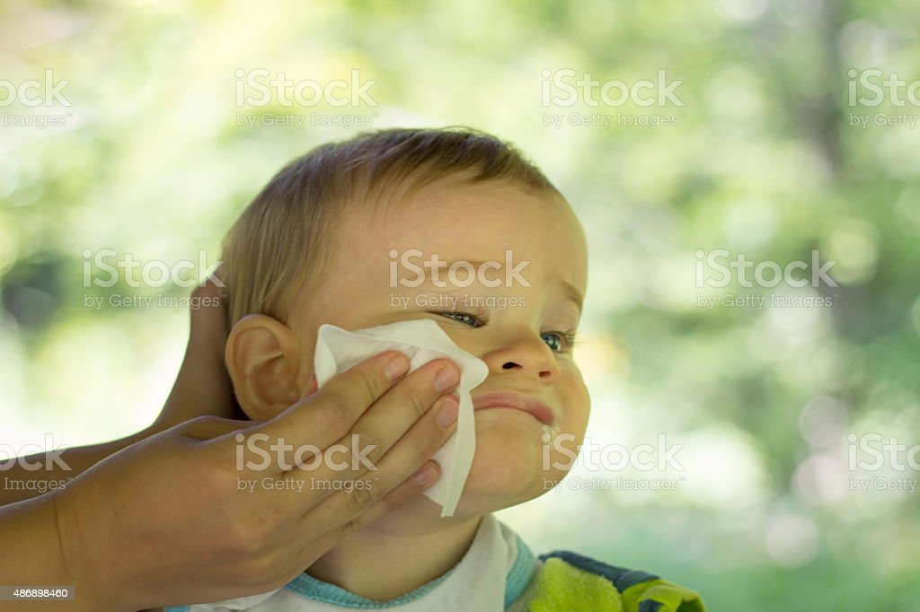 Mother cleans the baby stock photo