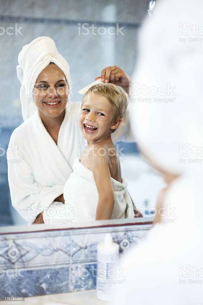 Mother combing son's hair royalty-free stock photo