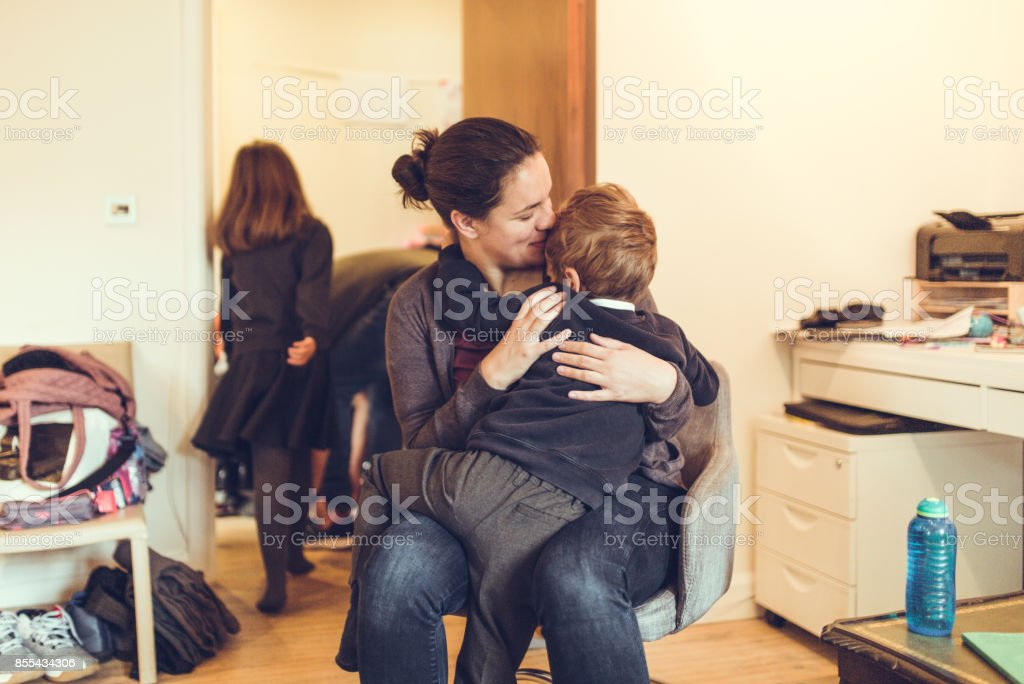 Mother comforting kid stock photo