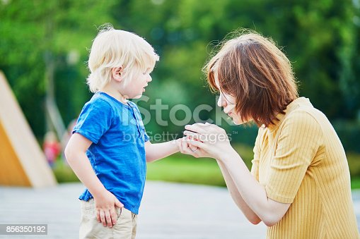 istock Mother comforting son after he injured his hand 856350192