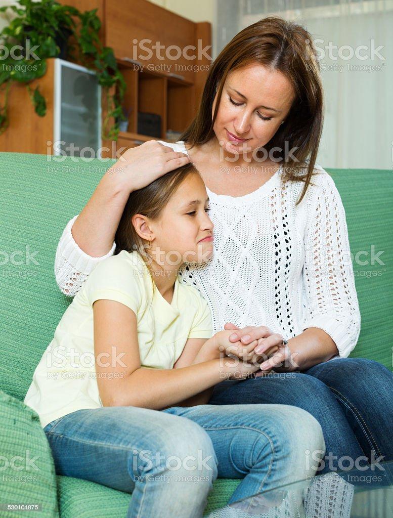 Mother comforting teen stock photo