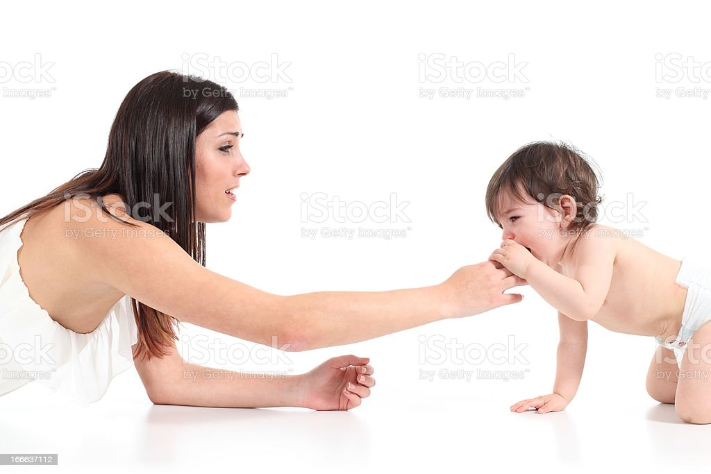 Mother consoling her baby crying royalty-free stock photo