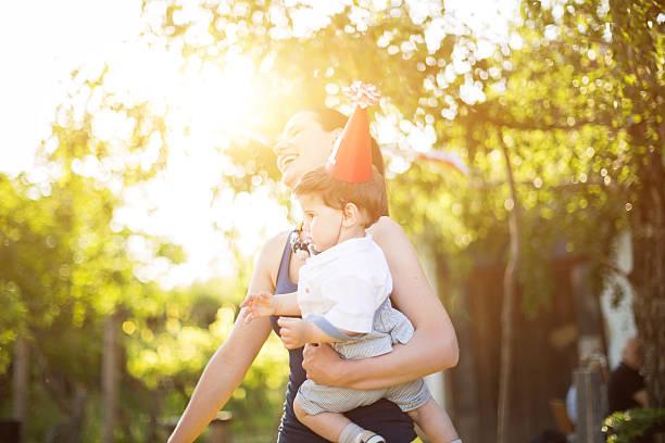 mother dancing with her baby boy on a party - alles gute zum geburtstag sohn stock-fotos und bilder