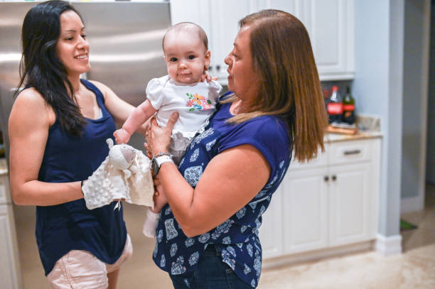 Mother daughter and granddaughter Latinx family candid at home stock photo