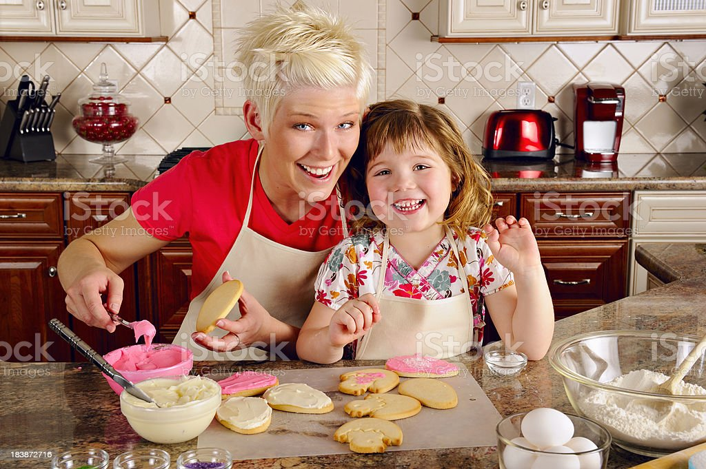 Mother Daughter Duo In The Kitchen Baking Cookies royalty-free stock photo