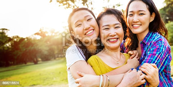 istock Mother Daughter Happiness Smiling Hug Concept 668218824