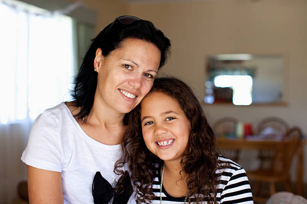 mother & daughter - maori stock photos and pictures