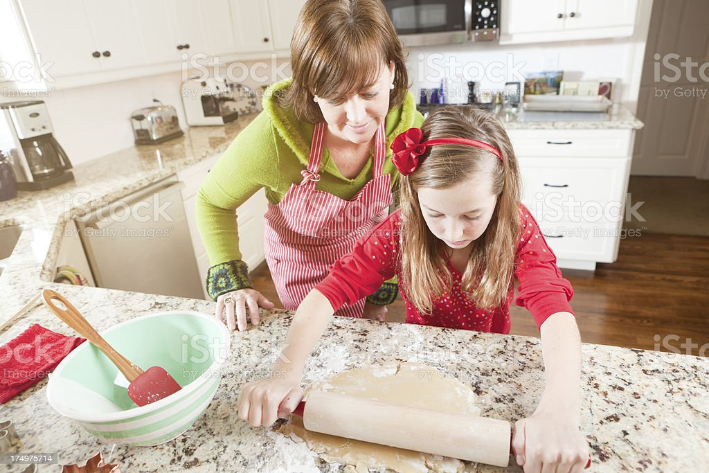 Mother Daughter Working Pastry Dough in Kitchen Hz royalty-free stock photo