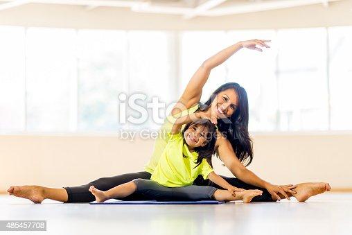 istock Mother Daughter Yoga Class 485457708